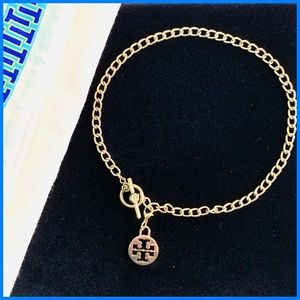 Brass Choker Toggle Necklace w/ Tory Burch Charm